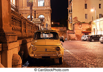 fiat 500 in Rome - vintage car in a Roman street at night