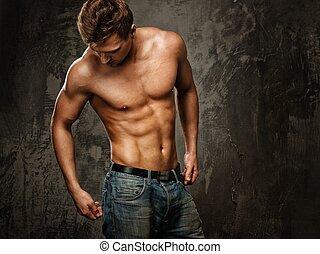 fiatalember, noha, erős, test, alatt, farmernadrág