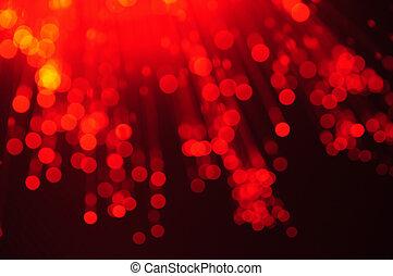 fiber optics red lights abstract background - defocused...