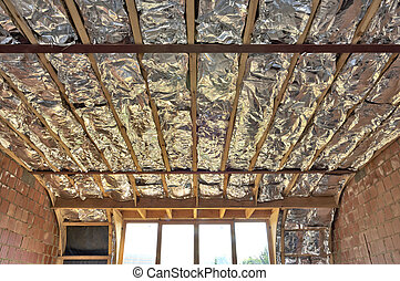 Fiberglass batt insulation between roof trusses at a house...