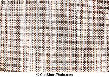 Edge of woven fiberglass cloth on a grunge wood background
