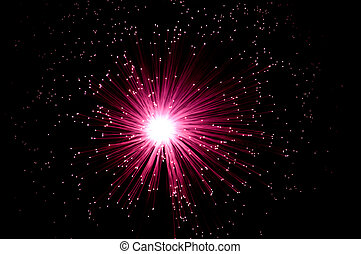 Fibre optic splash. - Overhead view capturing an illuminated...