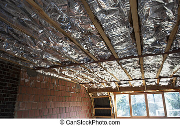 Fibreglass insulation installed in the sloping ceiling of a house.
