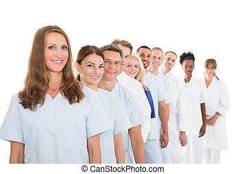 ficar, equipe médica, retrato, linha, sorrindo