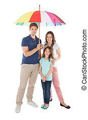 ficar, guarda-chuva, família, junto, abaixo, retrato