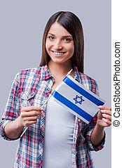 ficar, israelita, segurando, beleza, flag., israel, cinzento, contra, jovem, enquanto, fundo, bandeira, mulheres felizes