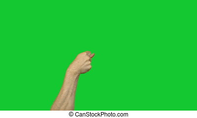 Fico gesture on green background - Footage of male hands on...