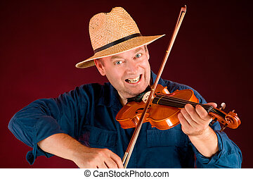 A man is playing country music on the fiddle.