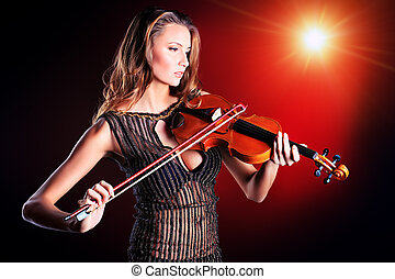 fiddle - Elegant young woman playing her violin with...