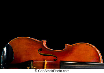 A Still life with the body of the fiddle, isolated on black