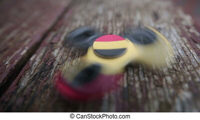 Fidget spinner close-up wiev on wooden background - Close up...