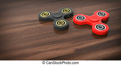 Fidget spinners on wooden background. 3d illustration
