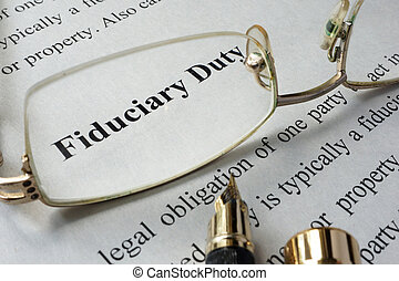 Fiduciary duty concept written on a paper.