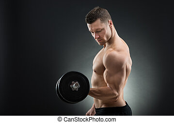 fiducioso, dumbbell, muscolare, sollevamento, uomo
