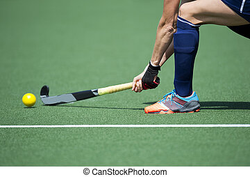 Field Hockey Passing - Field Hockey player, forcefully...