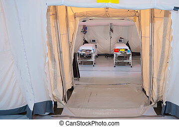 Field hospital tent with beds