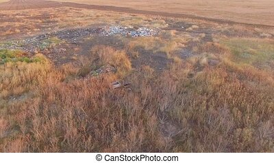 Field Littered With Garbage - AERIAL VIEW. In the frame...