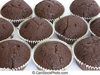 Field of chocolate muffins