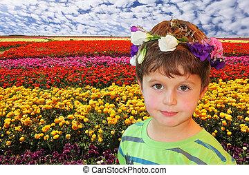 Handsome boy in wreath of flowers