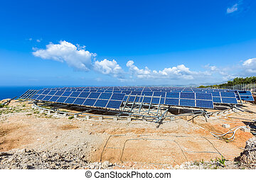 Field of solar collectors on rotatable construction