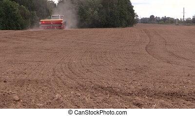 field soil fertilization - Soil earth and tractor spread...