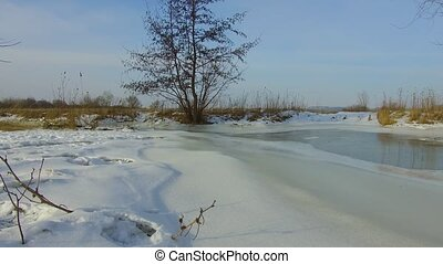Field with grass frozen and snow away the Russia outdoors...