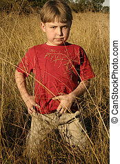 Fields of Gold - Boy standing in golden field