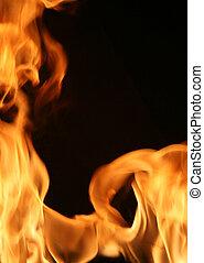 Fiery frame vertical - Flames bordering a blank, black area...