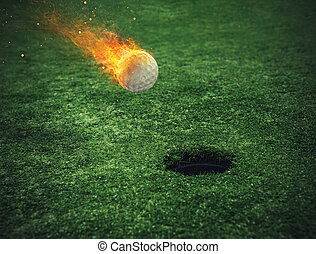 Fiery golf ball near the hole in a grass field - Fiery golf ...