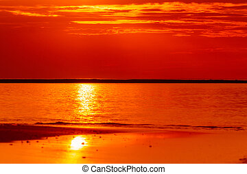 Fiery orange sunset sky over the sea, Sunset sky background