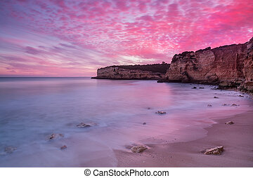 Fiery red sky at Seascape in Portugal. Algarve.