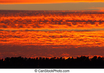 Fiery red sunset clouds sky