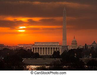 Fiery sunrise over monuments of Washington