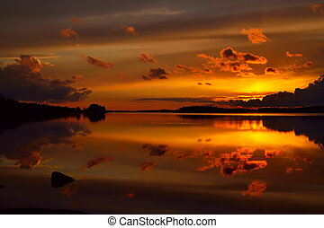 Fiery sunset. Lake Pongola, Northern Karelia, Russia