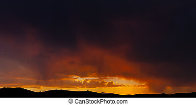 Fiery Sunset with rain on the horizon