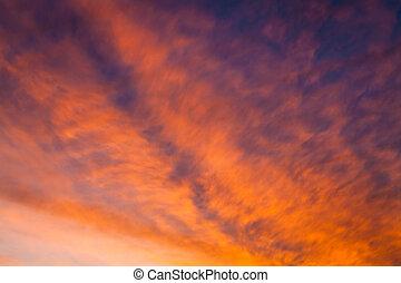 Fiery vivid sunset sky clouds