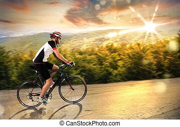 fietser, op, ondergaande zon