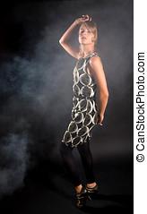 Fifties revival - Beautiful blond girl dancing in smoke in...