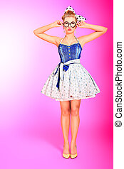 fifties style - Beautiful young woman with pin-up make-up...