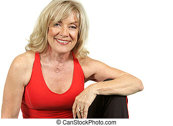 A beautiful fifty year old woman relaxing after a workout. Isolated with copy space for text.