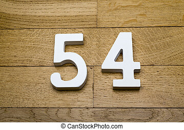 Fifty-four figures on a wooden parquet floor.