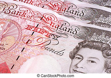Fifty Pound Notes - Close-up of an array of UK fifty pound...