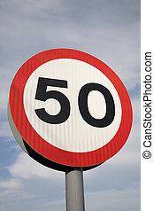 Fifty Speed Sign against Blue Sky Background