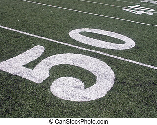 Fifty Yard Line - Angled shot of the fifty yard line on a...