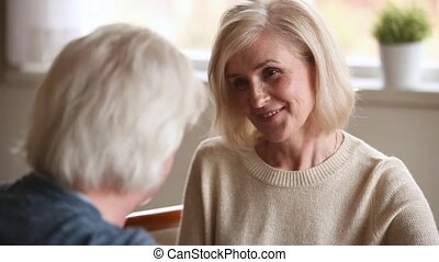 Fifty year old couple talking focus on woman in love - Fifty...