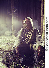 Fight to survive - Soldier wearing a gas mask in a forest