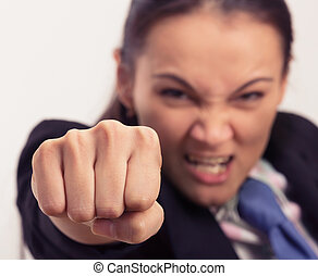 Young caucasian businesswoman starting to fight