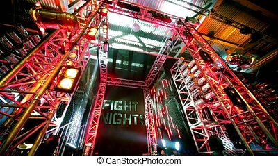 Fighter comes from metal gate with illumination at The...