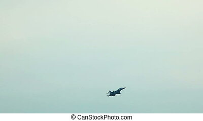 Fighter jet fly in cloudy sky on airshow