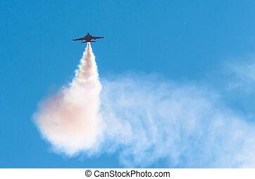 Fighter military combat flies in the sky.